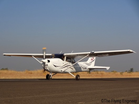 A Cessna 172 backtracking on runway 35.