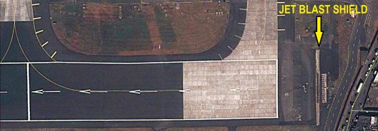 The Jet Blast shield located near the threshold of Runway 27. The visible gap in the centre is the portion that was jet-blasted away in 2012.
