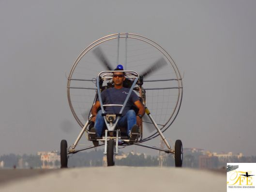 Nikolai runs his Cruiser Powered Paraglider (PPG), minus the wing, on the runway, making sure everything is right.