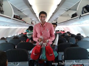 AirAsia India CFO Vijay Gopalan handing out caps and mugs to passengers of the first flight.